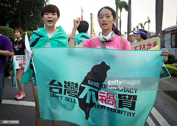 Protestors demonstrate against the meeting between Taiwan's President Ma Ying-jeou and Chinese President Xi Jinping in Singapore on November 7, 2015...