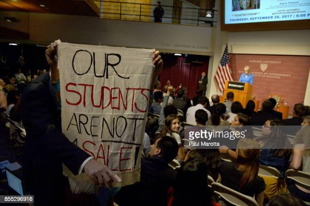 Protestors demonstrate as Education Secretary Betsy DeVos speaks at the Harvard University John F Kennedy Jr Forum on 'A Conversation On Empowering...