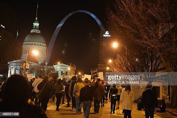 Protestors demonstrate during a silent protest in the streets of downtown St Louis Missouri on March 14 2015 Ferguson Missouri hit the headlines in...