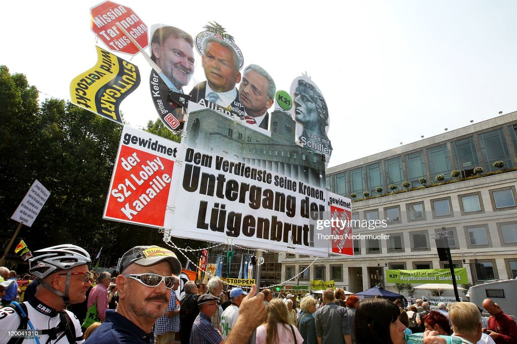 Protestors demonstrate during the conferece between the conflicting parties in the Stuttgart 21 railway station project on July 29, 2011 in Stuttgart, Germany. Heiner Geissler presents the results of the so called stress test, a computer based simulation of the capacity of the new railwaystation. The Stuttgart 21 project will replace the city's current terminal train station with a more efficient underground station and allow the creation of a new residential and office district in the city center. Thousands of irate activists oppose the project, citing the high cost, environmental impact and uncertain technical aspects.