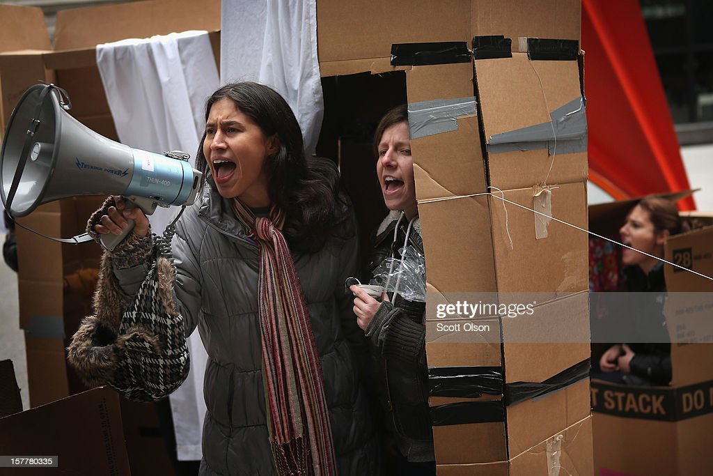 Protestors demonstrate from a shantytown constructed of cardboard in the Federal Building Plaza on December 6, 2012 in Chicago, Illinois. The shantytown, which they dubbed 'Durbinville' after U.S. Senator Dick Durbin (D-IL), was built to persuade Durbin to push for an increase of taxes on the wealthy and oppose cuts in Social Security, Medicare, and Medicaid