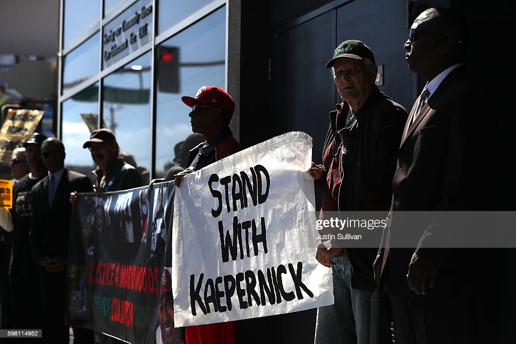 Protestors demonstrate in support of San Francisco 49ers quarterback Colin Kaepernick outside of the San Francisco Police Officers Association offices on August 31, 2016 in San Francisco, California. Kaepernick has come under fire for refusing to stand during the Star Spangled Banner in protest of what he complains is oppression of blacks and other peoples of color. The San Francisco Police Officers Association has written a letter to the NFL and San Francisco 49ers asking for an apology from Kaepernick for comments he made about police officer training.