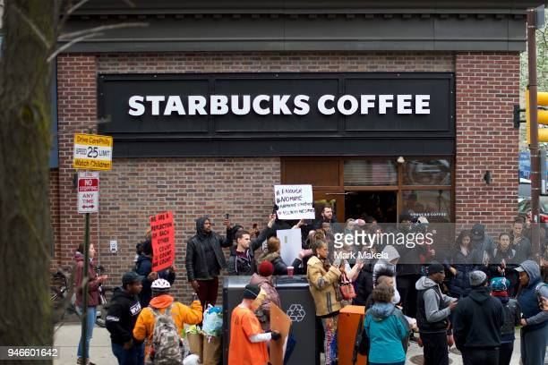 Protestors demonstrate outside a Center City Starbucks on April 15 2018 in Philadelphia Pennsylvania Police arrested two black men who were waiting...