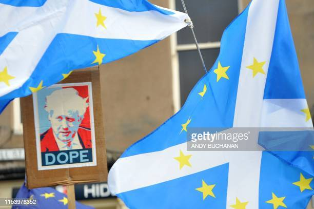 Protestors demonstrate outside a Conservative Party Hustings event in Perth, Scotland, on July 5, 2019. - Britain's leadership contest is taking the...