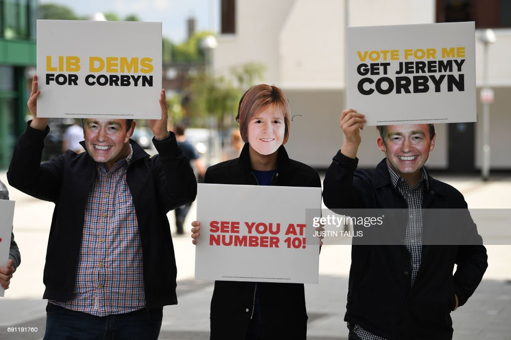 Protestors demonstrate outside a Labour Party election campaign event in Basildon, east of London on June 1, 2017. / AFP PHOTO / Justin TALLIS