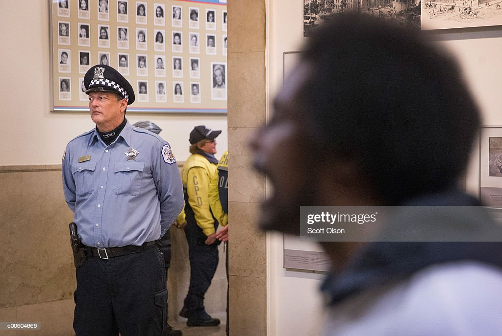 Protestors demonstrate outside the city council chambers y as Chicago Mayor Rahm Emanuel addresses a special session of the City Council as his administration continues to come under fire as allegation of extreme misconduct in the Chicago Police Department continue to surface on December 9, 2015 in Chicago, Illinois. Many people are calling for the mayor to resign, accusing him of trying to cover up the misconduct.