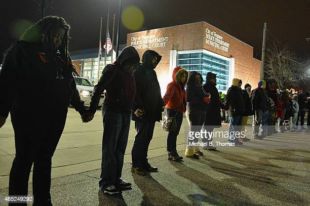 Protestors demonstrate outside the Ferguson Police Department in Ferguson Missouri on March 4 2015 The Federal Department of Justice decided today...