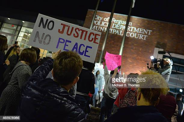 Protestors demonstrate outside the Ferguson Police Department on March11 2015 in Ferguson MO Protests erupted after the announcement of the...