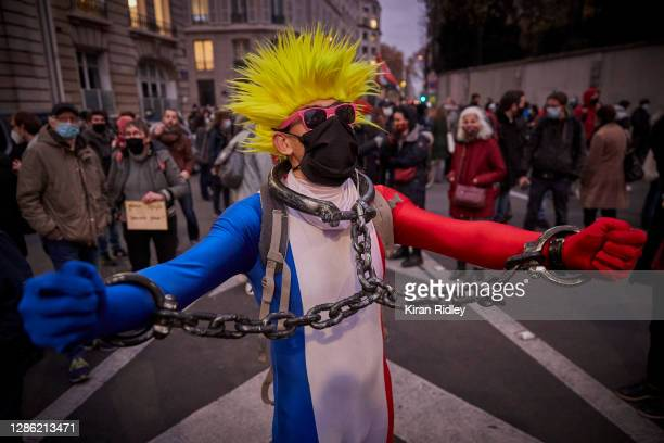 Protestors demonstrate outside the National Assembly in protest to the French Government's proposed global security law bill on November 17, 2020 in...