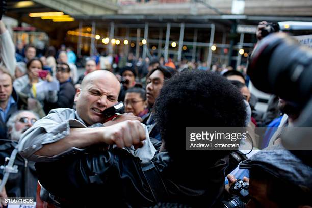 Protestors demonstrating outside a Trump fundraising event scuffle with a Trump supporter in midtown Manhattan on April 14 2016