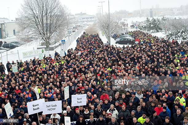 Protestors display placards as they demonstrate outside Swedish carmaker Saab's main plant in Trollhattan, south-western Sweden, on January 12, 2010....