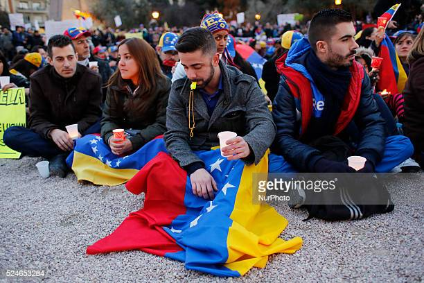 Protestors display Venezuelan flags during a protest against Venezuela's government in Madrid Spain Saturday Feb 22nd 2014 Venezuelans around the...