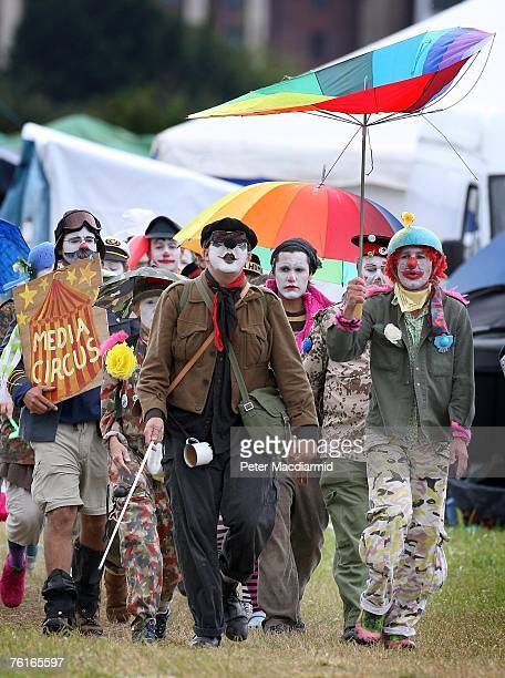 Protestors dressed as circus clowns march around the climate change camp near Heathrow airport on August 18 2007 in London Campaigners are calling...