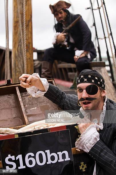 Protestors dressed as pirates pose for a Christian Aid photocall ahead of the G20 Finance Ministers meeting at The Golden Hinde galleon in central...