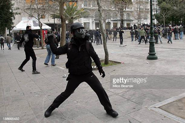 Protestors during a demonstration involving thousands of civilians on February 10 2012 in Athens Greece The demonstrations took place during a 48hour...