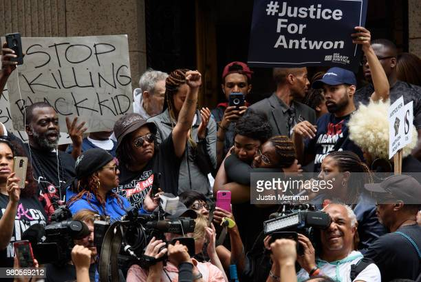 Protestors embrace as more than 200 people gathered for a rally to protest the fatal shooting of an unarmed black teen at the Allegheny County...