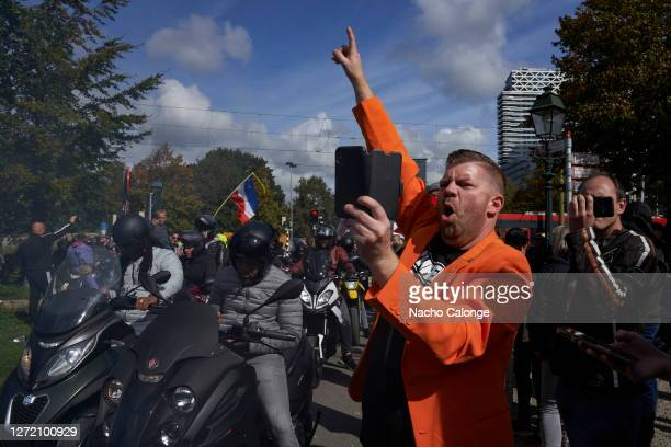 Protestors encouraging groups of bikers who came to support the demonstrationn against paedophilia held on September 12 2020 in The Hague Netherlands...