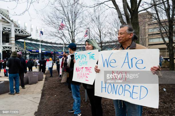 Protestors express their disapproval of the Cleveland Indians Chief Wahoo logo prior to the game against the Kansas City Royals outside Progressive...