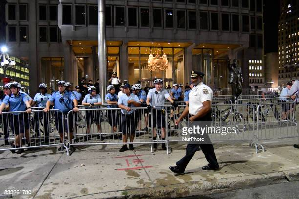 Protestors face a police force at an attempt to take down the statue of former Mayor and police commissioner Frank Rizzo across from City Hall in...
