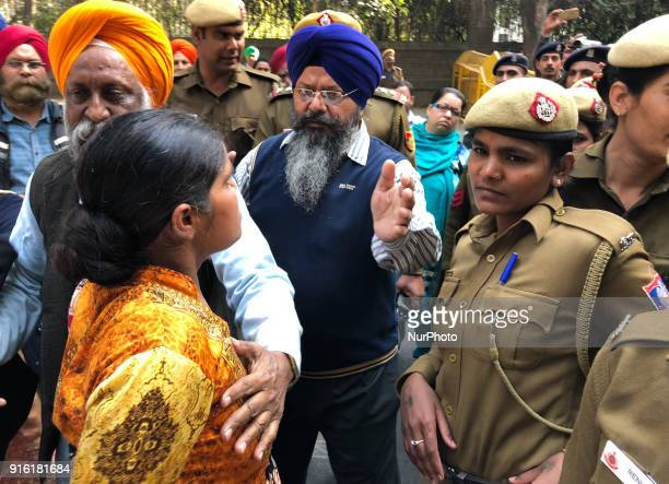 Protestors fight against Delhi Police guards as they demand arrest of Congress leader Jagdish Tytler for his alleged involvement in the 1984...