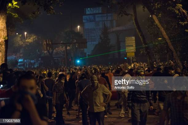 Protestors fight Istanbul police to reach the Prime Minister's building June 2 2013 in Istanbul Turkey People started peacefully protesting the...