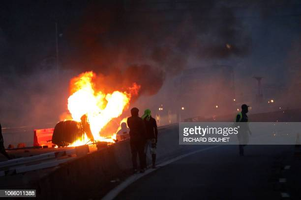 Protestors fight the police on a road in La Possession on the Indian Ocean island of La Reunion on November 27 to demonstrate against high fuel...