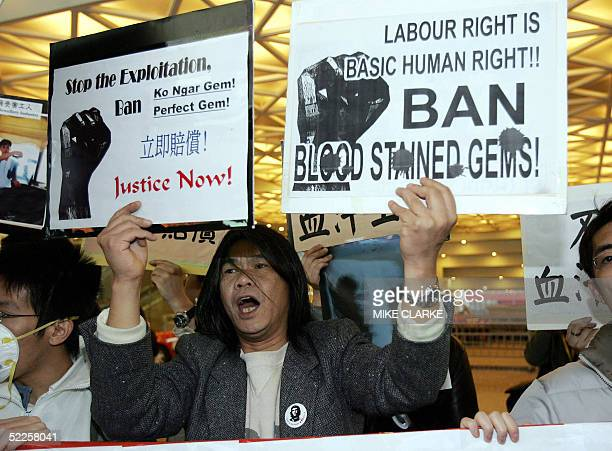 Protestors from a workers rights group, shout slogans outside the Convention Center in Hong Kong 01 March 2005 during the start of theInternational...