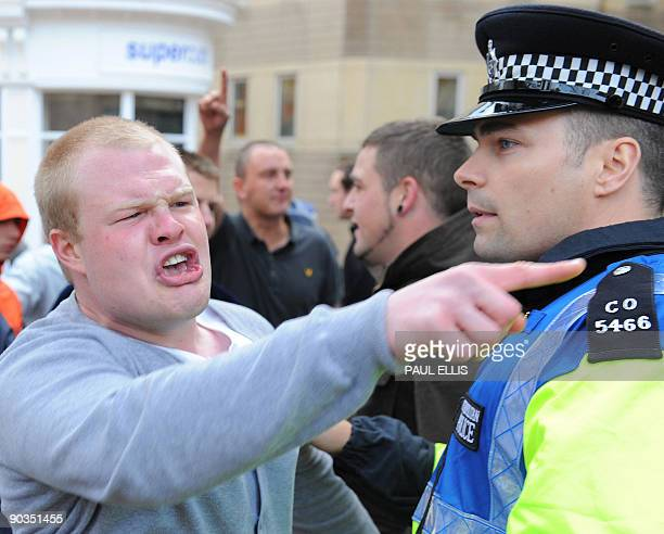 Protestors from the English Defence League take part in a dmonstration against Islamic extremism in Birmingham central England on September 5 2009...