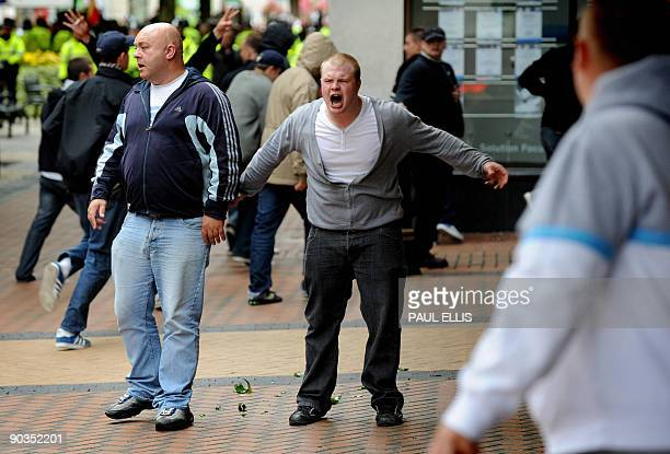 Protestors from the English Defence League take part in a demonstration against Islamic extremism in Birmingham central England on September 5 2009...
