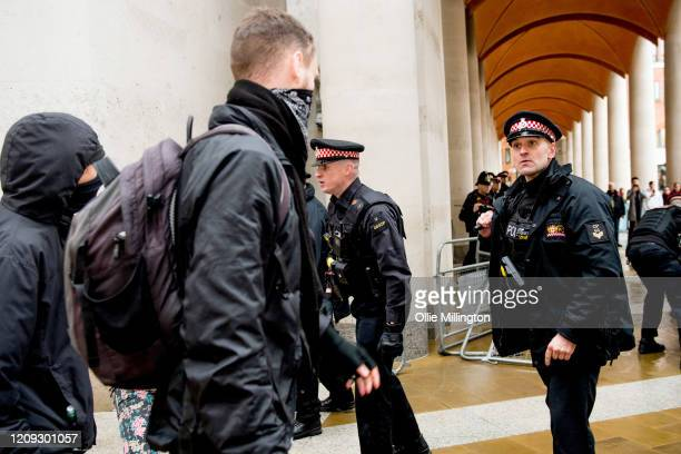 Protestors from the Green Anti-Capitalist Front clash with Police after the group entered the London Stock Exchange armed with smoke grenades during...