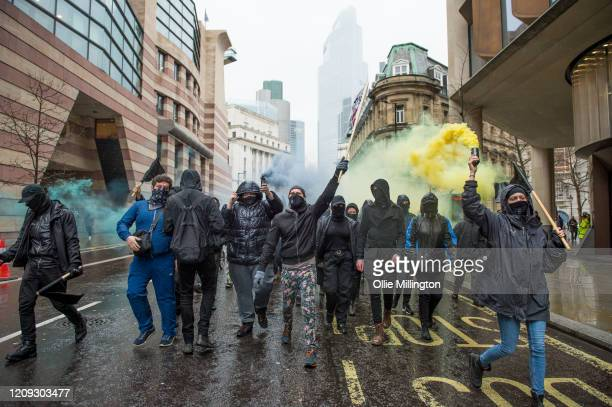 Protestors from the Green AntiCapitalist Front march through the streets around the Bank of England during the 'Rally Against Capital' on February 28...