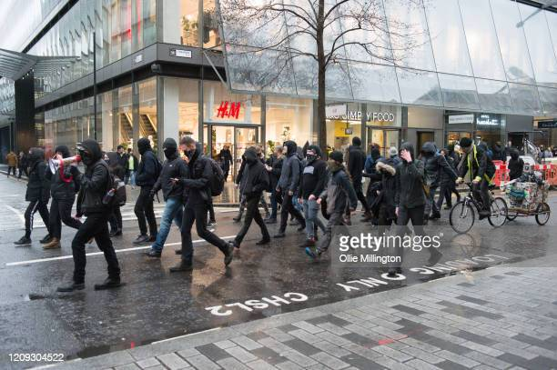 Protestors from the Green Anti-Capitalist Front march through the streets around the Bank of England during the 'Rally Against Capital' on February...