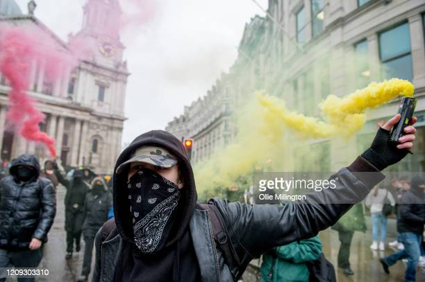 Protestors from the Green Anti-Capitalist Front march through the streets around St. Paul's Cathedral during the 'Rally Against Capital' on February...