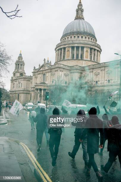 Protestors from the Green AntiCapitalist Front march through the streets around St Paul's Cathedral during the 'Rally Against Capital' on February 28...