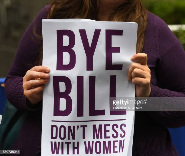Protestors from the National Organization for Women of New York hold a protest in front of the News Corporation Headquarters in New York April 20...