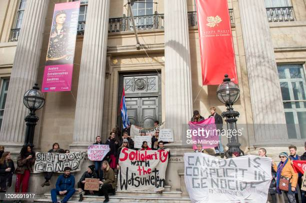 Protestors from twelve British climate emergency conscious groups hold a solidarity protest for The Wet'suwet'en First Nations people outside The...