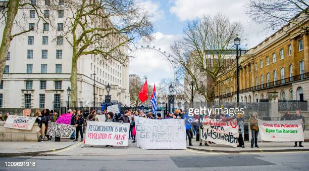 Protestors from twelve British climate emergency conscious groups hold a solidarity protest for The Wet'suwet'en First Nations people outside Downing...