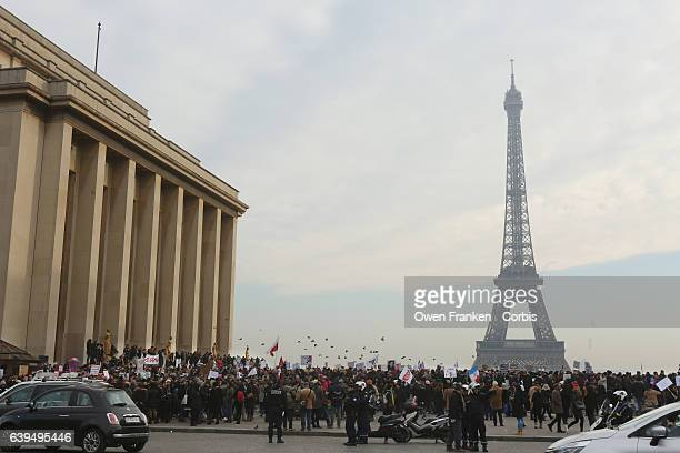 Protestors gather as over 2000 people protest during the Women's march on the Trocadero in front of the Eiffel Tower on January 21 2017 in Paris...