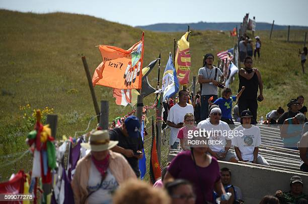 Protestors gather at the blocked entrance to a construction site for the Dakota Access Pipeline to express their opposition to the pipeline near an...