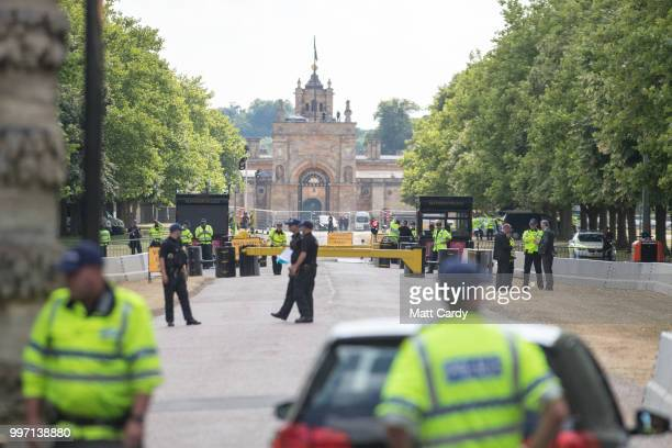 Protestors gather at the gates of Blenheim Palace where US President Donald Trump is due to visit for diner in Woodstock on July 12 2018 in...