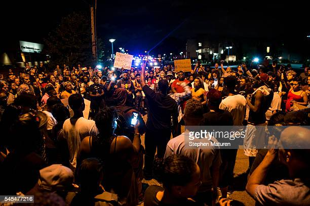 Protestors gather at the intersection where Philando Castile was shot on July 7 2016 in Falcon Heights Minnesota Castile was shot and killed by a...