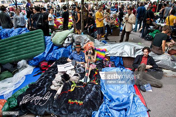Protestors gather at Zuccotti Park where hundreds of demonstrators have camped out in Lower Manhattan for 14 days on Friday, September 30, 2011....