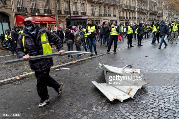 Protestors gather debris to build a barricade while clashing with police in central Paris December 1 2018 The quotYellow Vestquot movement began...