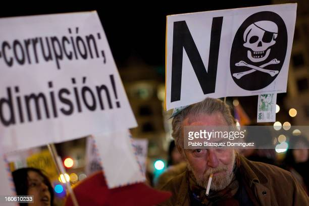 Protestors gather during a demonstration against alleged corruption scandals implicating the PP on the streets of Madrid on February 3 2013 in Madrid...