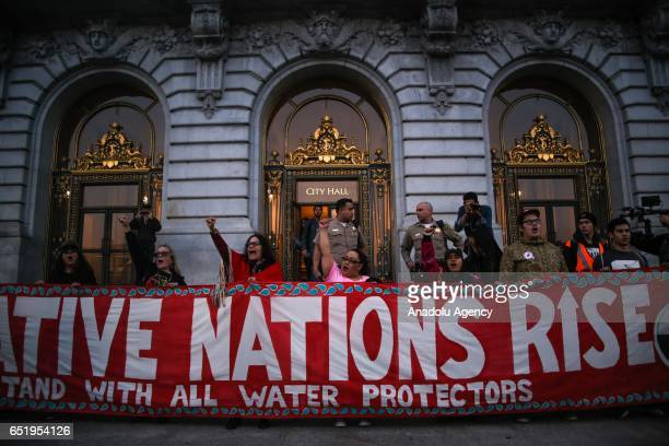 Protestors gather in front of City Hall during a protest in solidarity with the Standing Rock Sioux Tribe against the construction of the Dakota...