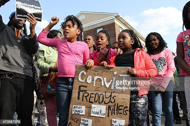 Protestors gather in front of the Baltimore Police Department's Western District police station to seek justice for the death for Freddie Gray who...