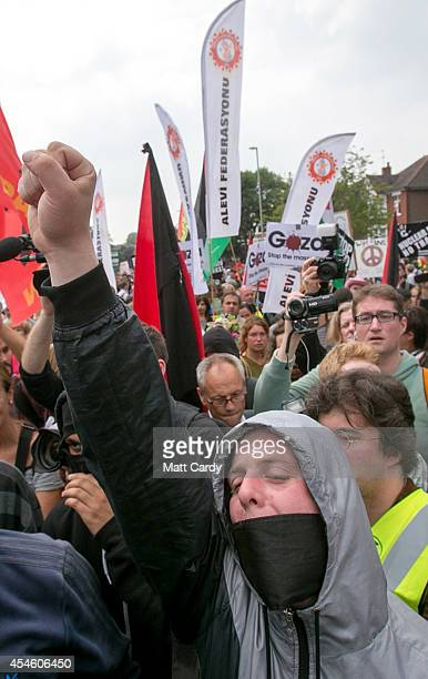 Protestors gather in front of the mobile police cordon as they demonstrate against the Nato Summit on September 4 2014 in Newport Wales Leaders and...
