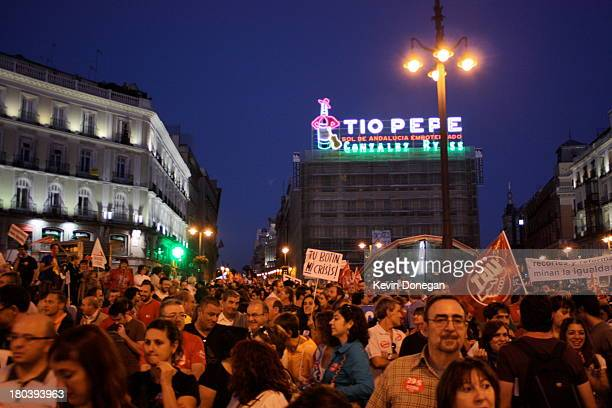 CONTENT] Protestors gather in Madrid's Puerta del Sol to protest the economic crisis