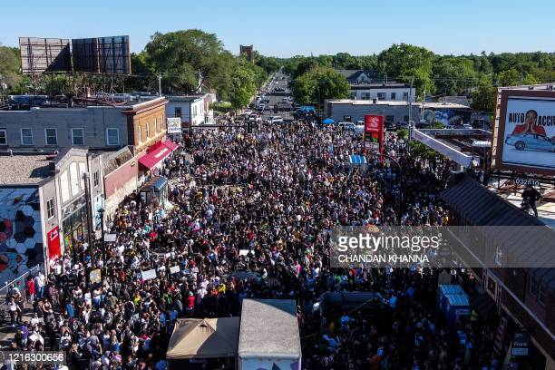 Protestors gather near the makeshift memorial in honour of George Floyd who died while in custody of the Minneapolis police following a day of...