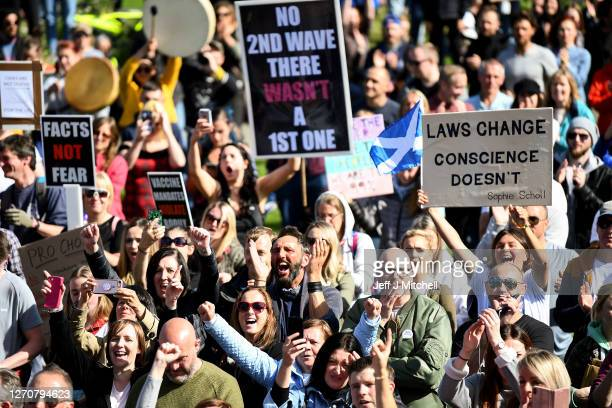 Protestors gather near the Scottish Parliament to demonstrate against a secondary lockdown coronavirus face covering rules and the search for a virus...